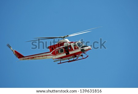 patrol helicopter of firefighters in blue sky - stock photo