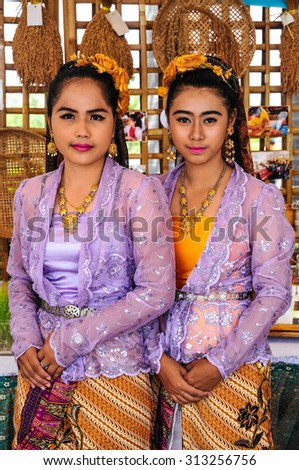PATTALUNG, THAILAND - AUGUST 30 : Unidentified Thai girl in traditional style clothes with typical welcome expression on August 30, 2015 in August, Pattalung Thailand.  - stock photo