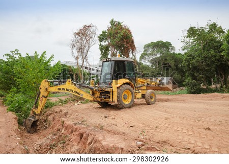 PATTAY A,THAILAND - JULY 20, 2015: The rusty heavy wheel loader excavator machine is working  in building site in Pattaya   - stock photo