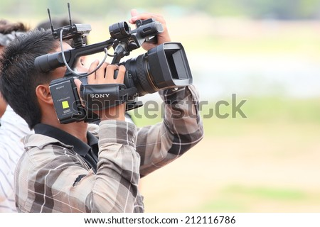 PATTAYA - AUGUST 17:Press are Video Recording  at the Buffalo Racing Festival of Nong Prue City at Mab Prachan Reservoir in Pattaya, Thailand on August 17, 2014.  - stock photo
