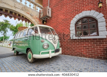 PATTAYA CHONBURI - APRIL,17  : The Volkswagen retro vintage van is parked in Swiss sheep farm Where have many tourists visiting here every holiday.THAILAND APRIL,17 2016 - stock photo
