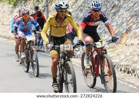 PATTAYA MOUNTAIN BIKE CHALLENCE THAILAND - APRIL 26- group of bikers are riding bikes in bicycle lane of at the mountain  on April 26 2015,  Pattaya  city Thailand - stock photo
