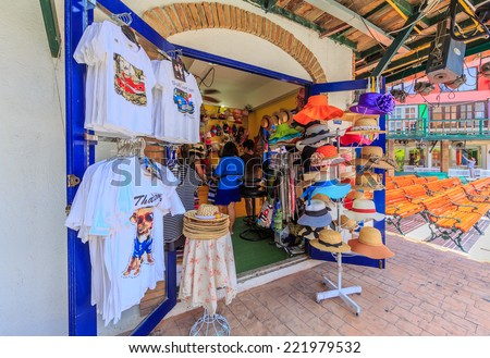 "PATTAYA, THAILAND - AUG 10: Souvenir shop at Mimosa on Aug 10, 2014 in Pattaya. It was established for tourist attraction by the concept of ""The City of Love"" through arts and architecture decorated."