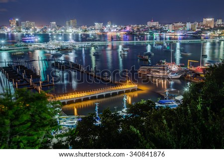 PATTAYA, THAILAND - CIRCA AUGUST 2015: Pattaya city lights at night are reflected in the bay, Thailand