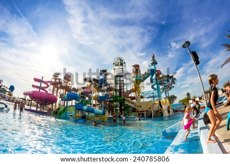 PATTAYA, THAILAND - December 29, 2014: Many travelers in Cartoon Network Amazone Water Park enjoy the cool water falling from big Omnitrix on top, on December 29, 2014 in Pattaya Thailand. - stock photo