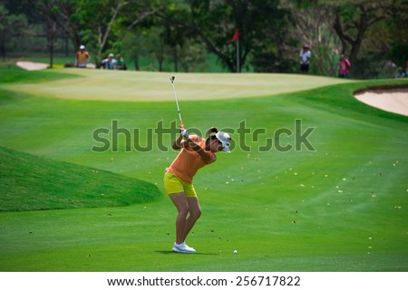 PATTAYA, THAILAND-FEB 26: Kang Haeji of South Korea plays a shot on the 1st hole during day one of the Honda LPGA Thailand 2015 at Siam Country Club, Pattaya on Feb 26,2015 in Thailand. - stock photo