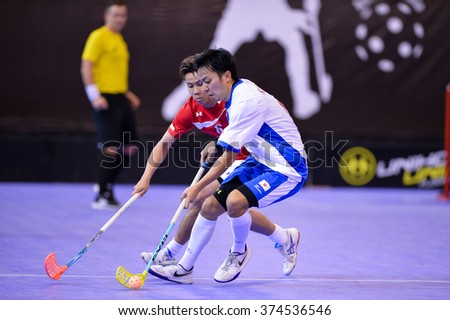 PATTAYA,THAILAND FEB5:Kimura Yasuhiti(White) of Japan contols the ball during the Men's World Floorball Championships Qualifications 2016 between Japan vs Singapore on February5,2016 in Thailand