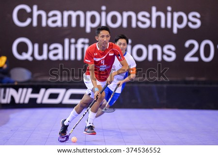 PATTAYA,THAILAND FEB5:Shah Hamka of Singapore controls the ball playing during the Men's World Floorball Championships Qualifications 2016 between Japan vs Singapore on February5,2016 in Thailand
