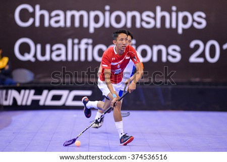 PATTAYA,THAILAND FEB5:Shah Hamka of Singapore run with the ball during the Men's World Floorball Championships Qualifications 2016 between Japan vs Singapore on February5,2016 in Thailand