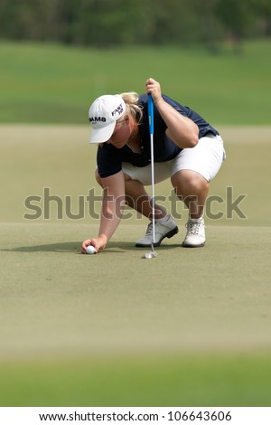 PATTAYA, THAILAND-FEBRUARY 16: Caroline Hedwall of Sweden prepares a ball to putt during Round 1 of Honda LPGA 2012 on February 16, 2012 at Siam Country Club Old Course in Pattaya, Thailand