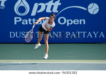 PATTAYA, THAILAND - FEBRUARY 8: Kai-Chen Chang of Taiwan takes her first serve during a match in Round 2 of PTT Pattaya Open 2012 on February 8, 2012 at Dusit Thani Hotel in Pattaya, Thailand