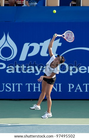 PATTAYA THAILAND - FEBRUARY 8: Kai-Chen Chang of Taiwan takes her first serve during a match in Round 2 of PTT Pattaya Open 2012 on February 8, 2012 at Dusit Thani Hotel in Pattaya, Thailand