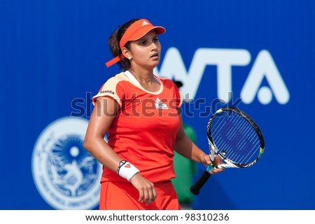 PATTAYA THAILAND - FEBRUARY 9: Sania Mirza of India reacts after losing a point during Round 2 of PTT Pattaya Open 2012 on February 9, 2012 at Dusit Thani Hotel in Pattaya, Thailand - stock photo