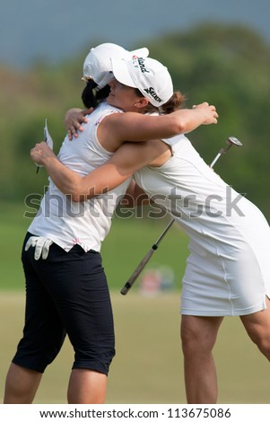 PATTAYA THAILAND - FEBRUARY 16: Se Ri Pak (R)&Paige MacKenzie (L) of USA hug after finish Day 1 of Honda LPGA Thailand 2012 on February 16, 2012 at Siam Country Club Old Course in Pattaya, Thailand