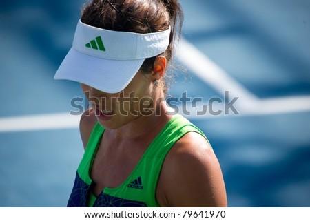 PATTAYA, THAILAND - FEBRUARY 8: Serbian tennis player Ana Ivanovic in action during round 1 of PTT Pattaya Open on February 8, 2011 at Dusit Thani Hotel in Pattaya, Thailand - stock photo