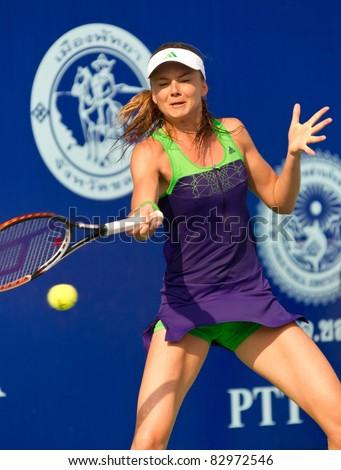 PATTAYA THAILAND - FEBRUARY 13: Slovakian tennis player Daniela Hantuchova returns the ball during the final game of PTT Pattaya Open on February 13, 2011 at Dusit Thani Hotel in Pattaya, Thailand - stock photo