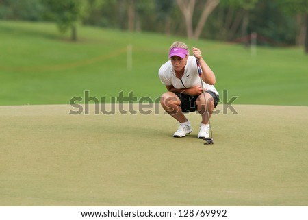 PATTAYA, THAILAND - FEBRUARY 17: Suzann Pettersen of Norway thinks of her next move on day 2 of Honda LPGA Thailand 2012 on February 17, 2012 at Siam Country Club Old Course in Pattaya, Thailand