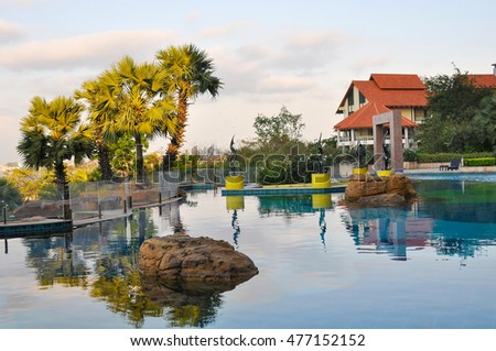 PATTAYA,THAILAND - FEBRUARY 28,2013:the hotel Grounds with a swimming pool in the Northern part of the city