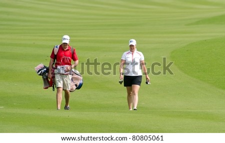 PATTAYA THAILAND - FEBRUARY 18: US player Brittany Lincicome walks towards hole 1 during Day 1 of Honda LPGA Thailand 2011 on February 18, 2011 at Siam Country Club Old Course in Pattaya, Thailand