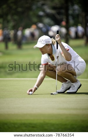 PATTAYA THAILAND - FEBRUARY 19: US player Cristie Kerr prepares a ball to putt during Day 3 of Honda LPGA Thailand 2011 on February 19, 2011 at Siam Country Club Old Course in Pattaya, Thailand