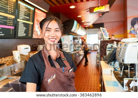 PATTAYA, THAILAND - FEBRUARY 21, 2016: worker at McCafe in Thailand. McCafe is a coffee-house-style food and drink chain, owned by McDonald's. - stock photo