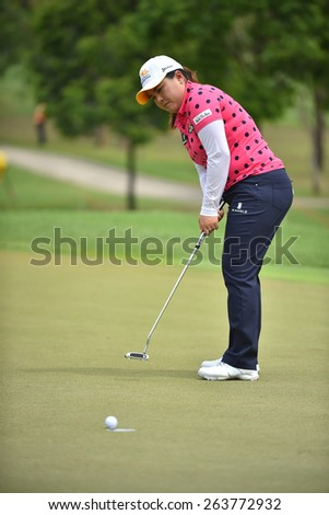 PATTAYA, THAILAND: Inbee Park of South Korea watches the ball after a put shot during day one of the Honda LPGA Thailand 2015 at Siam Country Club, Pattaya on Feb 26,2015 in Thailand. - stock photo