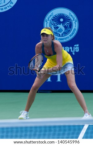PATTAYA THAILAND - JANUARY 31: Daniela Hantuchova of Slovakia prepares to return a serve during 1st round of PTT Pattaya Open 2013 on January 31, 2013 at Dusit Thani Hotel in Pattaya, Thailand - stock photo