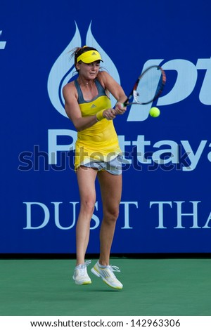 PATTAYA THAILAND - JANUARY 31: Daniela Hantuchova of Slovakia returns a ball during 1st round of PTT Pattaya Open 2013 on January 31, 2013 at Dusit Thani Hotel in Pattaya, Thailand - stock photo