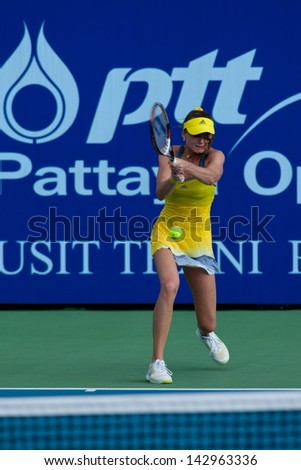 PATTAYA THAILAND - JANUARY 31: Daniela Hantuchova of Slovakia returns a ball during 1st round of PTT Pattaya Open 2013 on January 31, 2013 at Dusit Thani Hotel in Pattaya, Thailand - stock photo