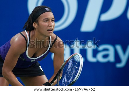 PATTAYA THAILAND - JANUARY 31: Heather Watson of Great Britain prepares to return a serve during 1st round of PTT Pattaya Open 2013 on January 31, 2013 at Dusit Thani Hotel in Pattaya, Thailand - stock photo