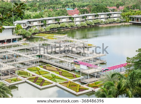 PATTAYA,THAILAND - JANUARY 18 : The steel building and tropical garden are located in Nong Noouch Tropical Garden on January 18,2016 at Pattaya,Thailand.