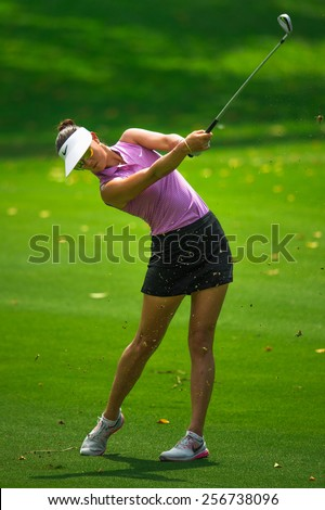 PATTAYA, THAILAND:Michelle Wie of USA hits the ball during day one of the Honda LPGA Thailand 2015 at Siam Country Club, Pattaya on Feb 26,2015 in Thailand. - stock photo