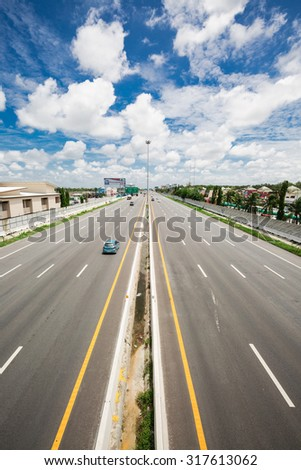 PATTAYA,THAILAND - SEPTEMBER 17 : The lanes with high speed cars on the motorway from Bangkok to Pattaya on Sep 17,2015  - stock photo
