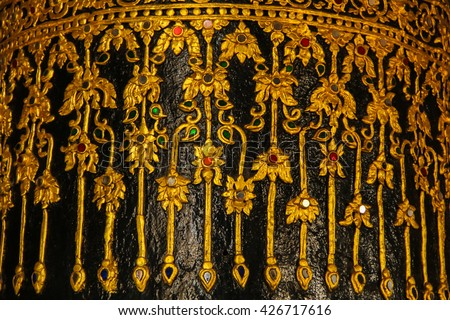 Pattern and texture is work of art as a ancient traditional Thailand on the pillars of the temple  - stock photo