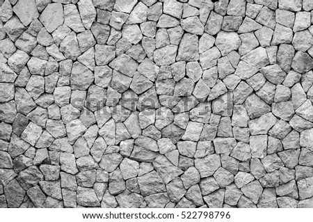 pattern  decorative uneven cracked real stone wall surface ,for background