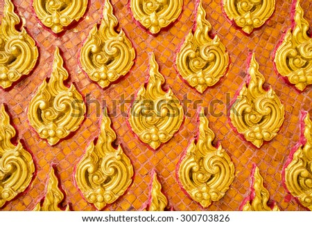 Pattern fire gold of thai traditional ornament paint on temple door wall - stock photo