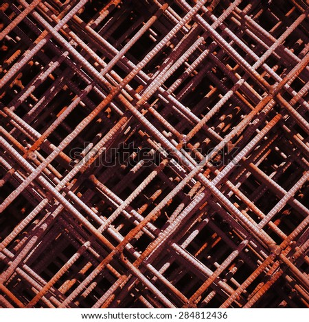 Pattern from rusty stack of rebar grids at the construction site. Top view - stock photo