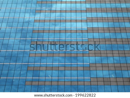 pattern glass window of office building - stock photo