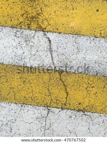pattern is street texture with white and yellow lines.