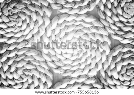 Pattern nature for background of handicraft weave white texture wicker surface. Closeup view. Darker from the centre