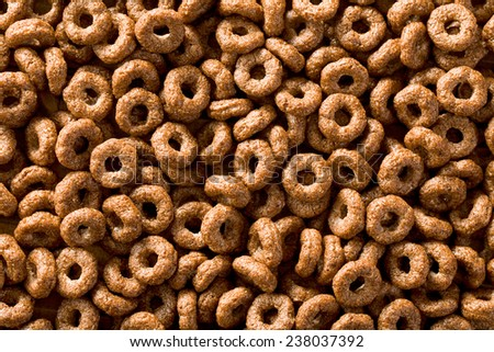 pattern of chocolate cereal rings - stock photo