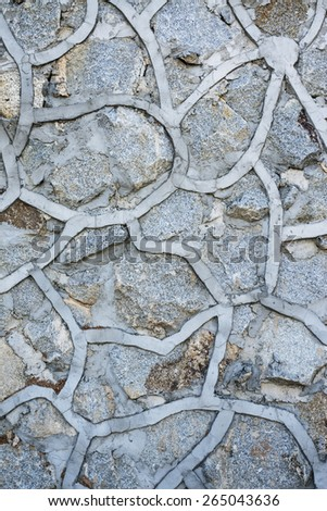 pattern of decorative stone wall surface with cement texture background - stock photo
