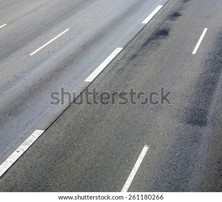 pattern of empty highway in grea with median stripes - stock photo