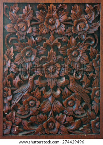 Pattern of flower carved on wood background,Thailand - stock photo