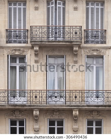 Pattern of French Windows. Buildings in the cities of France are patterned with traditional french doors and wrought iron black railings.