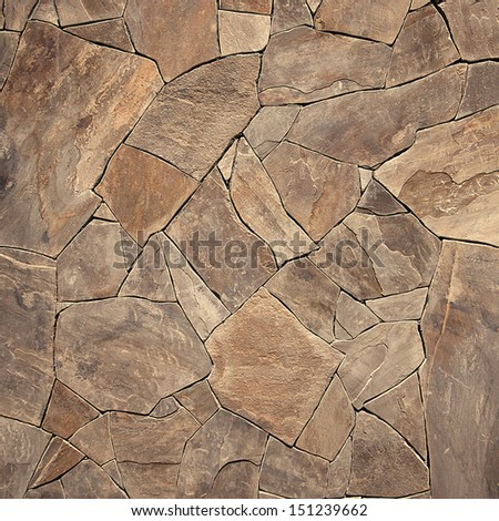 Pattern of modern style design decorative uneven cracked real stone wall surface with cement - stock photo