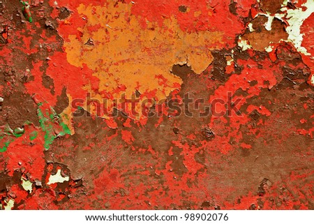 Pattern of old painted metal surface. Rusty metal, peeling paint, red tones, bright colors. - stock photo
