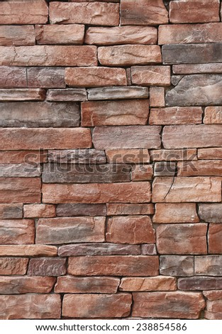 Pattern of old red stone Wall - stock photo