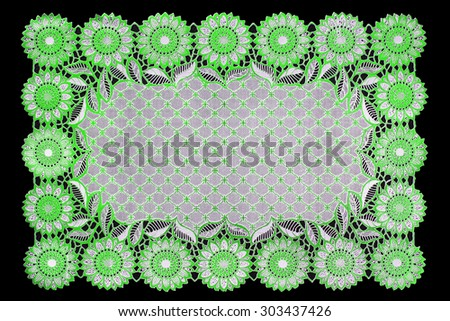 Pattern of Plastic green floral for tablecloth isolated on black background - stock photo