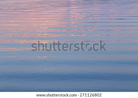 Pattern of reflections in rippling water. - stock photo